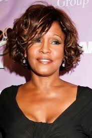 Whitney Houston singing and dancing elsewhere now