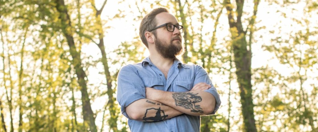 Justin Peter Kinkel-Schuster Arms Crossed Standing outside near trees